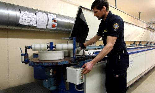 Fire Hose Maintenance machine - rolling the hose